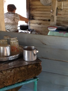 The farmer's wife brews coffee for our group