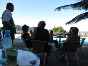 waiter and guests chat in the cool evening