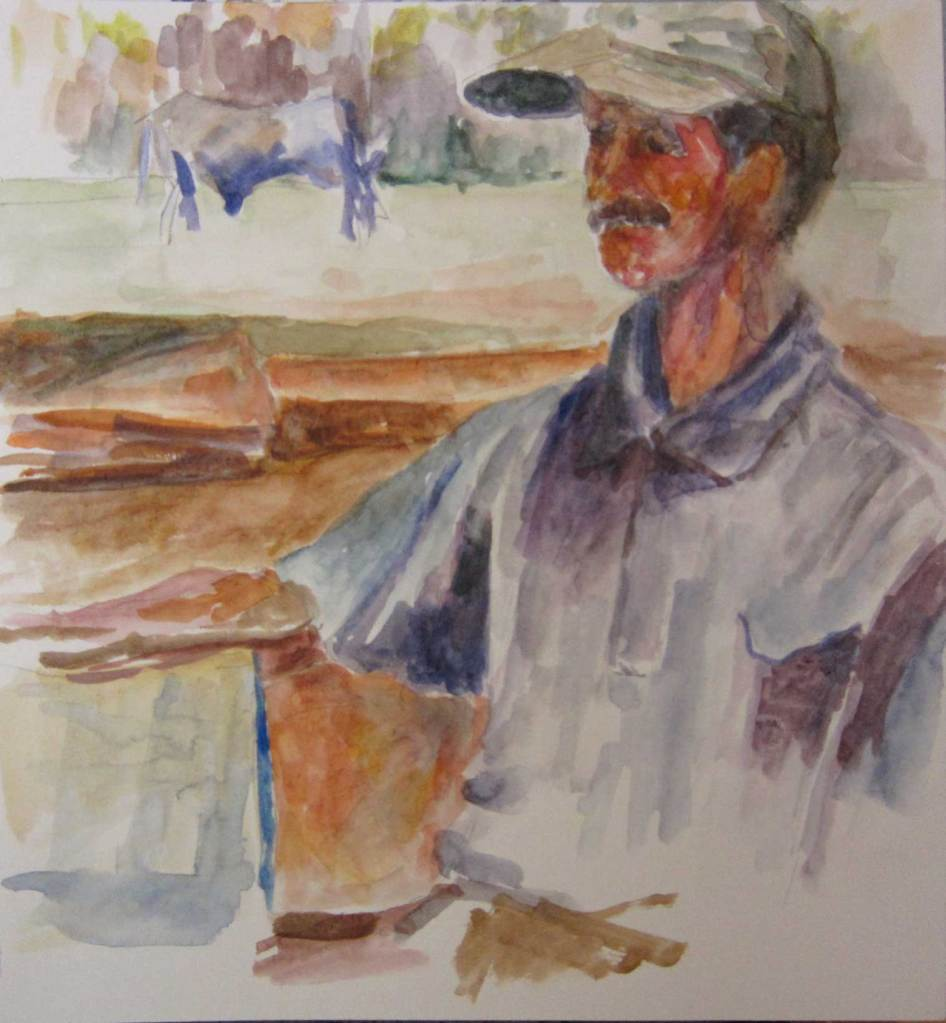 the tobacco farmer poses for us in his yard